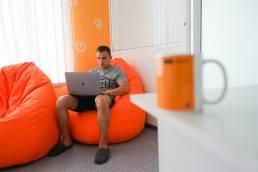 man in orange room
